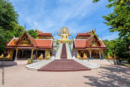 Garden Poster Temple Large gold buddha statue in a sitting position under the blue sky at Big Buddha Temple is a famous tourist destination of Koh Samui island, Surat Thani province, Thailand