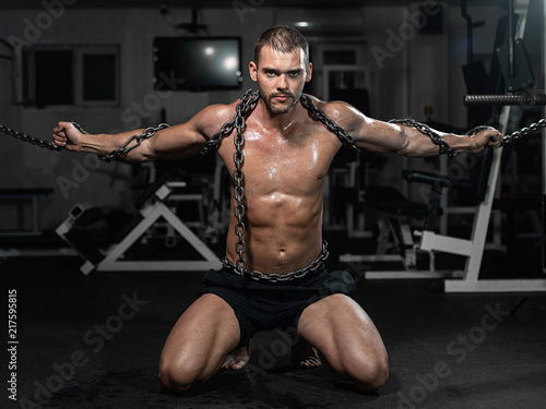 muscular male slave in chains
