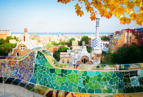Foto op Plexiglas Barcelona Gaudi bench and cityscape of Barcelona from park Guell, famous view of Barcelona, Spain at fall