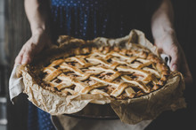 Hands Holding Homemade Delicious Apple Pie. Close Up