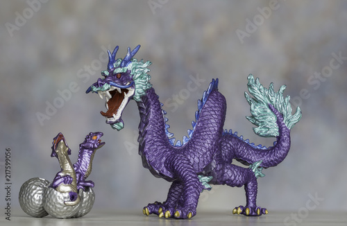 Fotografie, Obraz  Purple Dragon Figurine Protecting Its Hatching Chicks