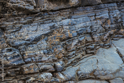 Fotografie, Obraz  jagged rock steps showing compacted eroded layers of sediment