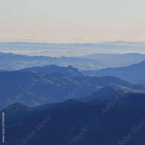 Colline Hills in the Bernese Oberland at sunrise. Emmental. View from Mount Niesen, Swiss Alps. A play of light and shadows.