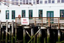 No Wake Sign On A Seaweed Cove...
