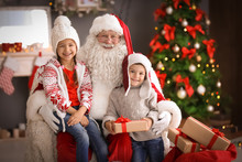 Little Children And Authentic Santa Claus Indoors