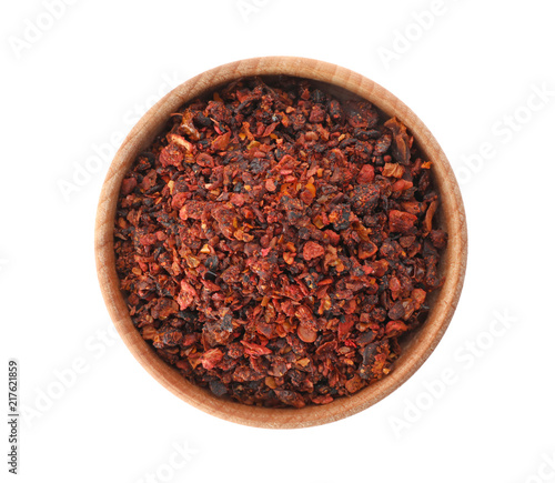 Keuken foto achterwand Kruiden Bowl with dried chili peppers on white background, top view. Different spices