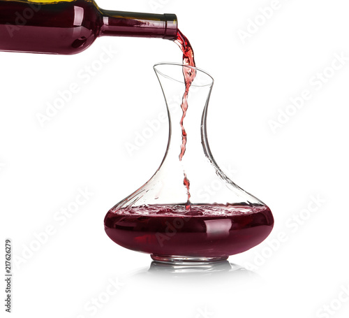Pouring red wine into elegant decanter on white background Canvas Print
