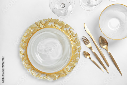 Elegant table setting on light background, top view