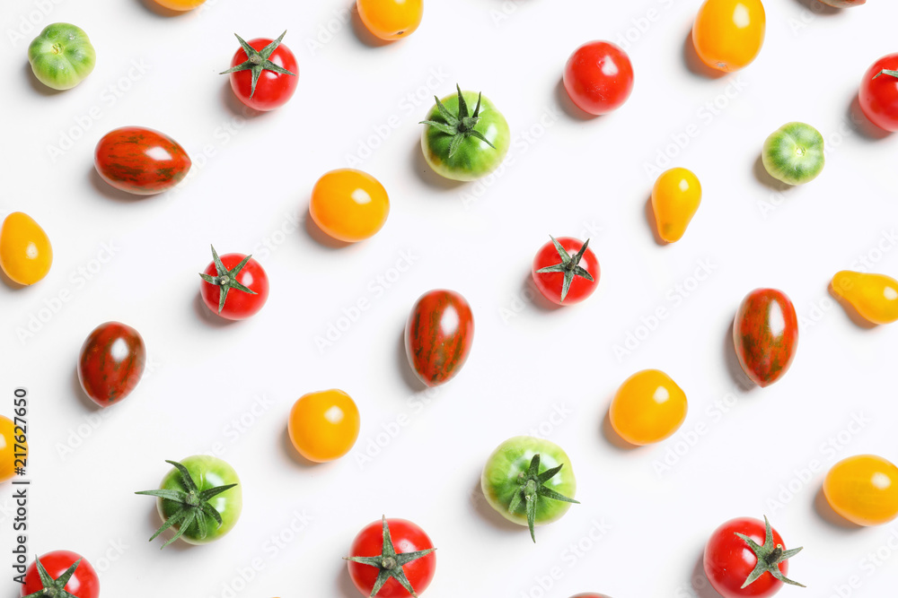 Flat lay composition with different tasty tomatoes on white background