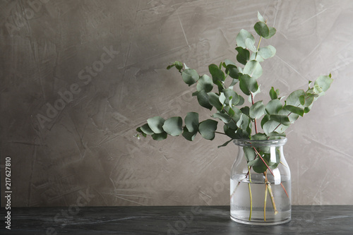 Foto op Plexiglas Historisch geb. Bunch of eucalyptus branches with fresh leaves in vase on table