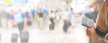 Closeup Of Girl Holding Passports And Boarding Pass At Airport , Panorama
