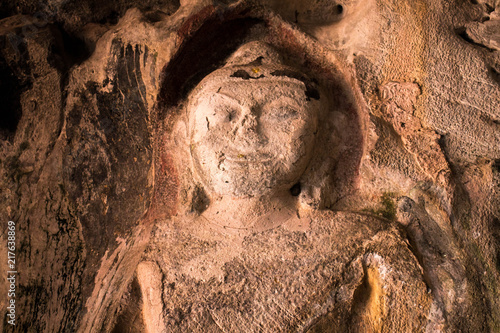 Valokuva  Amazing ancient Buddha statue on the wall of Thailand cave.