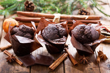 Chocolate Muffins On Wooden Table