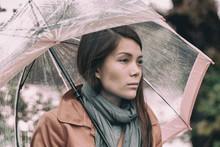 Autumn Rainy Grey Day Sad Girl Pensive. Asian Woman In Depression During Fall Season Mood Change.