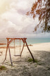 Swing chair on the beach, cloud sky and nice beach sand background.