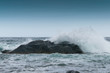 Waves are beating against rocks on the seashore, the ocean in cloudy weather.