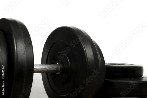 Fotografia  Dumbbell and plates isolated on white background