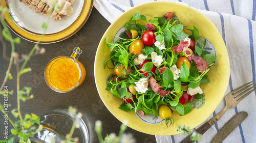 Healthy Watercress salad with tomato and cheese, top view/OLYMPUS DIGITAL CAMERA