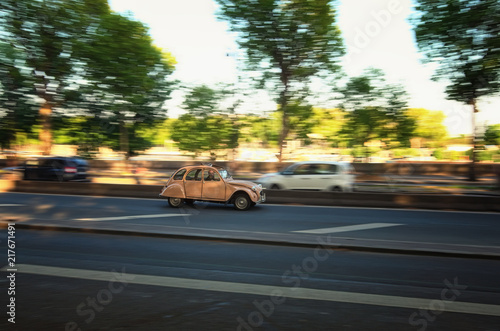 Photo  Paris, France-MAY 06, 2018: Vintage Citroen 2cv rides fast along the street of t