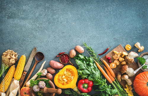 Fototapeta Healthy or vegetarian nutrition concept with selection of organic autumn fruits and vegetables obraz
