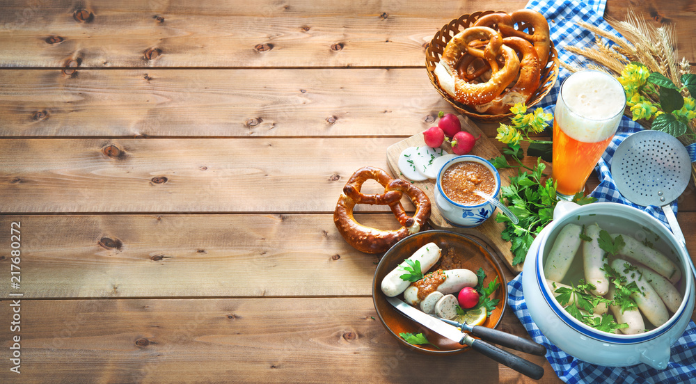 Fototapeta Bavarian sausages with pretzels, sweet mustard and beer on rustic wooden table