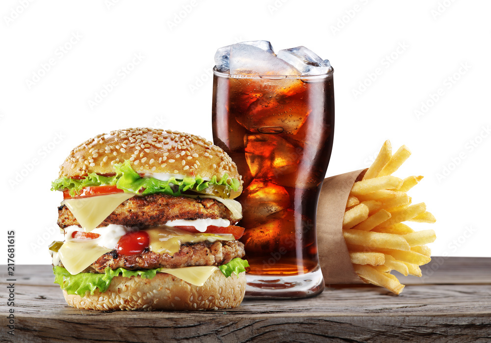 Fototapety, obrazy: Hamburgers, French fries and cola on the table.