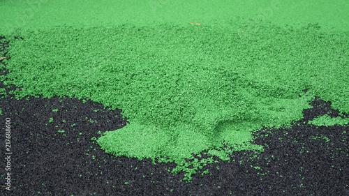 Fotografía  Black and green rubber crumb for children playground (under construction)