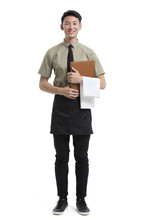 Young Waiter Holding A Menu