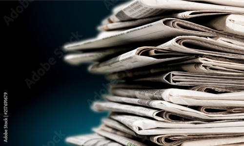 Pile of newspapers on white background Fototapeta