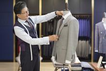 Confident Fashion Designer Working