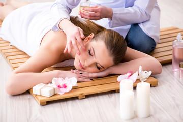 Obraz na płótnie Canvas Young woman during spa procedure in salon