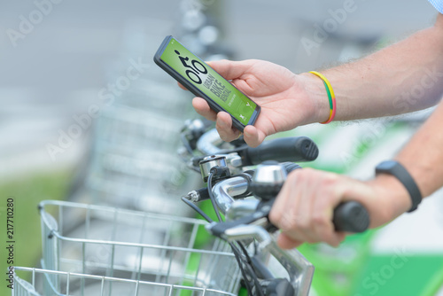 Renting bicycle from urban bicycle sharing station