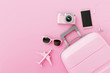 Leinwandbild Motiv Flat lay pink suitcase with traveler accessories on pastel pink background. travel concept. 3d rendering
