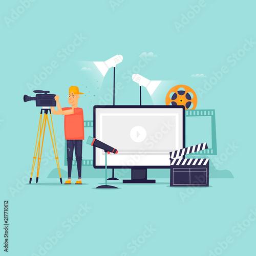 Fototapeta  Videography, a man with a camera shoots, a blog, a studio