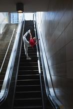 Female Street Dancer Dancing On Escalator