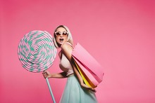 Model Posing With With Sweets And Shopping Bags