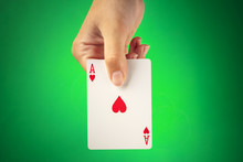 A Hand Holding An Ace Of Heart...
