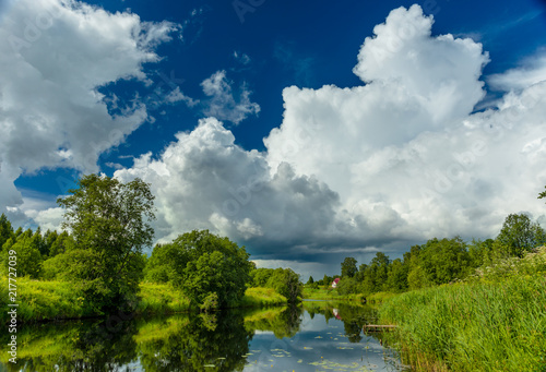 River is summer landscape. Sunny day, blue sky with beautiful clouds.
