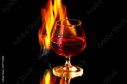 Cognac glass with the burning fire flames