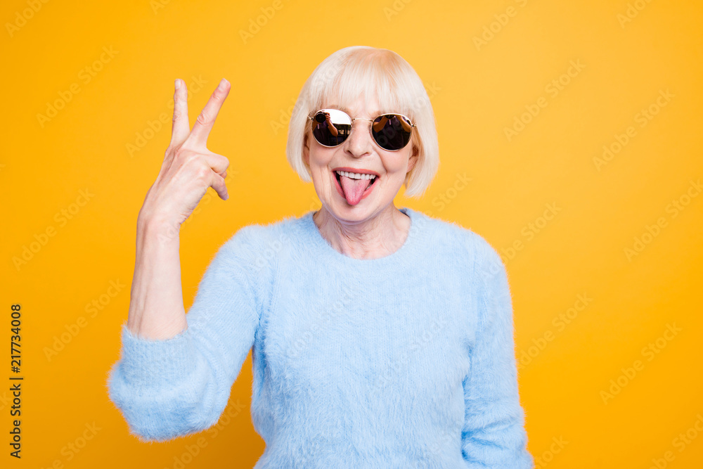 Fototapety, obrazy: Close up portrait of crazy modern grandma stuck out her tongue a