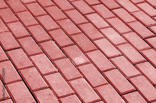Carta da parati Cobble stone pavement in red tone.
