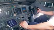 Aircraft handling process held by a professional pilot in a airplane cockpit