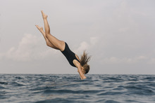 Side View Of Woman Diving Into...
