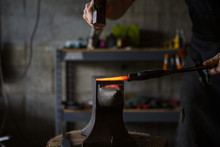 Blacksmith Forging Knife On An...