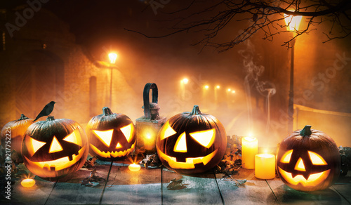 Fototapeta Scary horror background with halloween pumpkins jack o lantern