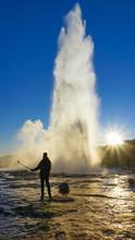 Male Tourist Took Photo Himself In Between Geysir Hot Spring Eruption.