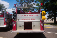 Back Of Red Fire Truck With The Words Keep Back 500 Feet And Members Only Panted In Red On The Chrome In The Back