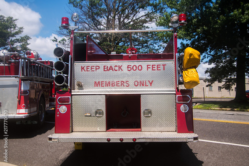 Obraz na plátne Back of red fire truck with the words Keep Back 500 Feet and Members Only panted