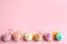 Flat Lay Composition With Delicious Birthday Cupcakes And Space For Text On Color Background