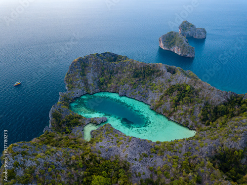 Aerial view of a spectacular shallow lagoon in the middle of a small tropical is Canvas Print